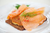 Salmon Slices On Reibekuchen In Plate — Stock Photo