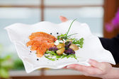 Seasoned salmon dish with herbs — Stock Photo