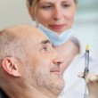 Dentist Injecting Anesthesia — Stock Photo