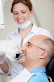 Dentist Taking Xray Of Man's Teeth At Clinic — Stock Photo