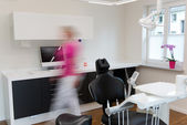 Blurred Motion Of Woman Walking At Dentist's Office — Stock Photo