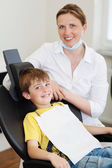 Smiling boy and dentist — Stock Photo