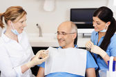 Dentist Explaining Teeth Model To Male Patient — Stock Photo