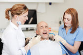 Dentists Examining Patients Mouth With Tools — Stock Photo