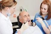 Dentists Using Dental Drill And Sucker — Stock Photo