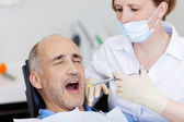 Dentist Injecting Anesthesia To Patient — 图库照片