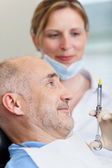 Dentist Injecting Anesthesia — Photo