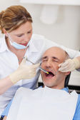 Dentist Injecting Anesthesia To Patient Before Treatment — 图库照片