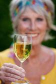 Senior woman toasting with wineglass — Stock Photo