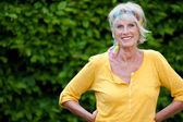 Confident senior woman in the garden — Stock Photo