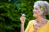 Senior Woman Smoking Cigarette At Park — Stock Photo