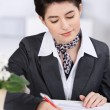 Receptionist completing a form — Stock Photo