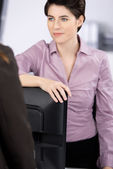 Businesswoman Communicating With Coworker — Stock Photo