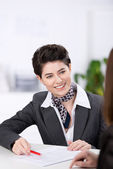 Smiling customer relations supervisor — Stock Photo