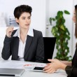 Businesswomen Discussing In Meeting At Desk — Stock Photo #27460043