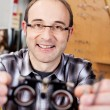 Confident opticiholding test lenses — Stock fotografie #27466651