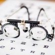 Stock Photo: Eye Test Glasses On Snellen Chart