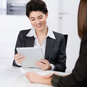 Businesswoman Using Digital Tablet With Coworker — Stock Photo