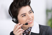 Customer Service Executive Conversing On Headset In Office — Stock Photo