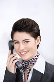 Businesswoman Conversing On Landline Phone In Office — Stock Photo