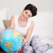 Woman Searching For Travel Destination On Globe — Stock Photo