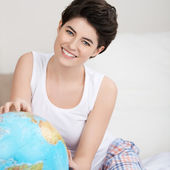 Happy Woman Searching For Travel Destination On Globe — Stock Photo
