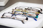 Various eyeglasses lying on a tray — Stock Photo