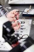 Optician repairing glasses — Stock Photo