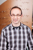 Confident Optician Standing In Store — Stock Photo
