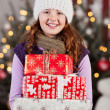 Pretty girl with an armful of Christmas gifts — Stock Photo