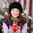 Beautiful young girl with a Christmas bauble — Stock Photo