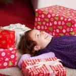 Little girl lying dreaming of Christmas day — Stock Photo