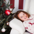 Girl lying waiting for the Christ Child — Stock Photo