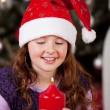 Little girl holding the Christmas candle — Stock Photo #27478707
