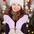 Young girl with a white Christmas heart — Stock Photo