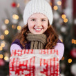 Winter child with Christmas gifts — Stok fotoğraf