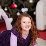 Little girl waiting for the Christ Child — Stock Photo #27479381