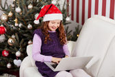 Little girl sending Christmas emails — Stock Photo