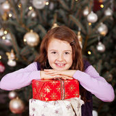 Pretty happy girl with her Christmas gifts — Stock Photo