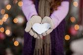 Child with white Christmas heart — Stok fotoğraf