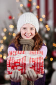 Winter child with Christmas gifts — Stockfoto