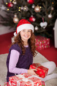 Young girl in front of the Christmas tree — Stockfoto