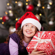 Little girl holding her Christmas gift — Stock Photo