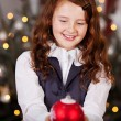 Smiling girl with a Christmas ball — Stock Photo