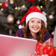 Stock Photo: Beautiful young girl wearing a red Santa hat