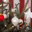Christmas decorations on a Christmas tree — Stock Photo