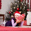 Small girl hugging her Christmas present — Stock Photo