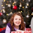 Joyful little girl with a Christmas gift — Foto de Stock