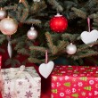 Stock Photo: Gift boxes under the Christmas tree