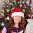 Beautiful laughing girl in a Santa hat — Stockfoto